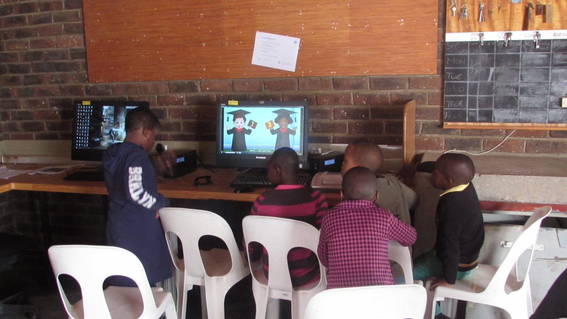 students learning to use computer